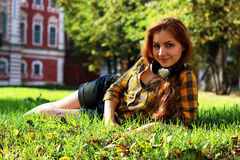 Red-haired girl in a park sunny day outdoor Royalty Free Stock Photography