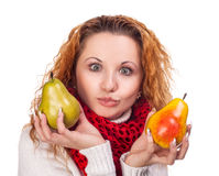 Red-haired girl with a pears Royalty Free Stock Image