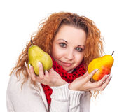 Red-haired girl with a pears Stock Photo