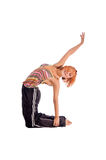 Red haired girl performing fitness exercises Stock Photos