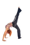 Red haired girl performing fitness exercises Royalty Free Stock Photo