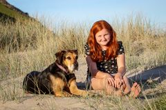 Red haired girl with pet dog