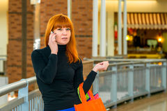 Red-haired girl on the phone Stock Photos