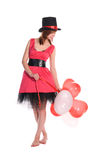 Red haired girl in pink dress and cylinder hat Royalty Free Stock Image