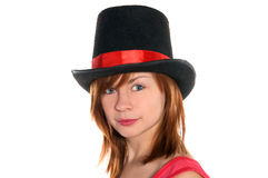 Red haired girl in pink dress and cylinder hat Stock Photography