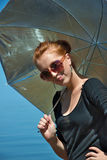 Red haired girl. Portrait of a pretty red haired girl with umbrella Royalty Free Stock Photos