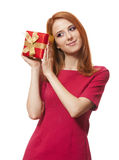 Red-haired girl with present box. Stock Image