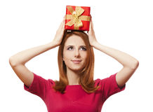 Red-haired girl with present box. Stock Photos
