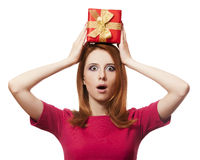 Red-haired girl with present box. Royalty Free Stock Images
