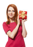Red-haired girl with present box. Stock Images