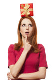 Red-haired girl with present box. Royalty Free Stock Photography