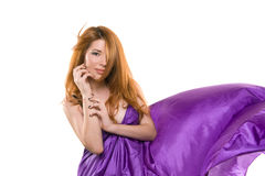 Red-haired girl in a purple dress Stock Photos