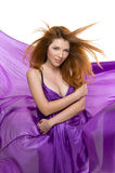 Red-haired girl in a purple dress Royalty Free Stock Photography