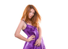 Red-haired girl in a purple dress Royalty Free Stock Image
