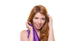 Red-haired girl in a purple dress Stock Images