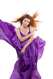 Red-haired girl in a purple dress Royalty Free Stock Photos