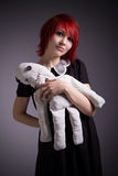 Red-haired girl with a rag doll royalty free stock photography