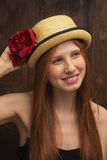 Red-haired girl with red flower Royalty Free Stock Photography