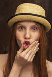 Red-haired girl with red hat Royalty Free Stock Image