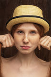 Red-haired girl with red hat Stock Photos