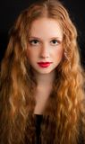 Red-haired girl with red lips Royalty Free Stock Photo