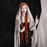 Red-haired girl with red lips and pale skin and tear Royalty Free Stock Photos