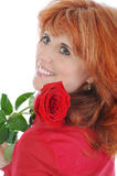 Red-haired girl with a rose Royalty Free Stock Photo