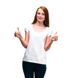 Red-haired girl showing thumbs up. Isolated on white background Royalty Free Stock Photos