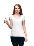 Red-haired girl shows  finger on t-shirt. Isolated on white back Stock Photo