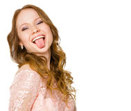 Red-haired girl shows tongue Stock Images