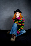 Red-haired girl sits Royalty Free Stock Photos