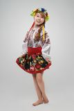 Red-haired girl in the Slavic national costume Stock Photos