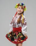 Red-haired girl in the Slavic national costume Stock Images