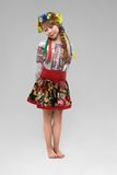 Red-haired girl in the Slavic national costume shy Royalty Free Stock Photography