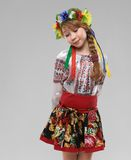Red-haired girl in  Slavic national costume shy Royalty Free Stock Image