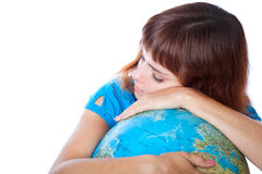 The red-haired girl is sleeping on the globe Royalty Free Stock Photos