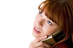 Red haired girl speaking on cell phone close-up. Beautiful red haired girl speaking on cell phone face close-up on white background Stock Photo