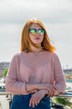 Red-haired girl is in sunglasses Stock Photography