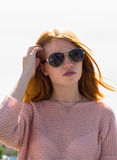 Red-haired girl is in sunglasses Royalty Free Stock Photos