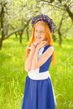 Red-haired girl in a sunny garden Royalty Free Stock Photography