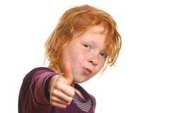 Red haired girl with thumbs up Stock Images