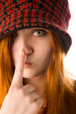Red haired girl touching her nose Stock Photos