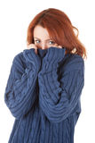 Red-haired girl is trying to keep warm Stock Photo