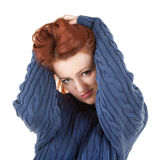 Red-haired girl is trying to keep warm Royalty Free Stock Images