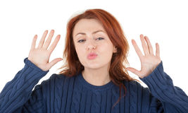 Red-haired girl is trying to keep warm Royalty Free Stock Photo