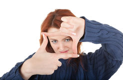 Red-haired girl is trying to keep warm Royalty Free Stock Image