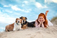 Red haired girl with two pet dog