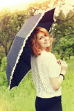 Red-haired girl and umbrella Royalty Free Stock Photography