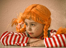 Red-Haired Girl with Upward Braids. Sad Red-Haired Girl with Upward Braids Royalty Free Stock Photo
