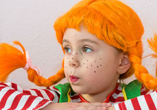 Red-Haired Girl with Upward Braids. Sad Red-Haired Girl with Upward Braids Stock Photos